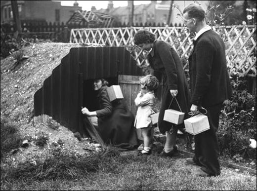 A family entering an Anderson Shelter