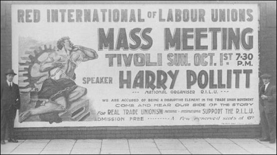 Harry Pollitt, left standing beside a poster for a meeting organised by the CPGB (1922)