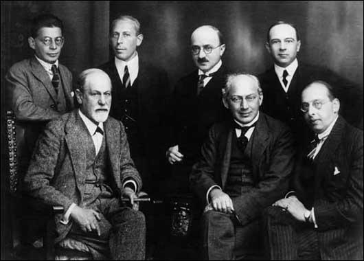 Standing, left to right, Otto Rank, Karl Abraham, Max Eitingon and Ernest Jones. Seated, left to right, Sigmund Freud, Sandor Ferenczi and Hanns Sachs.