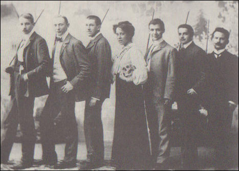 Karen Danielsen, holding skull, poses with fellow students with dueling swords (1906)