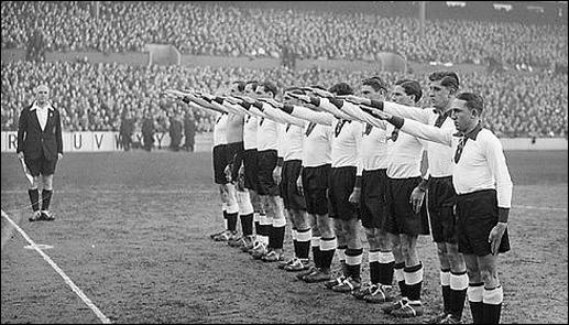 The German football team give the Nazi salute (4th December, 1935)