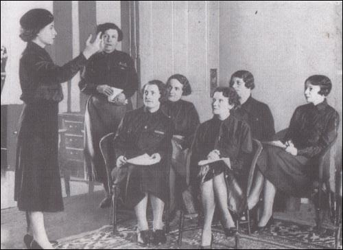 Mary Richardson (back left) looks on during a speakers' class for women members of the British Union of Fascists.