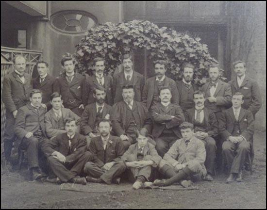 Photograph of the first students at Ruskin College. Edward Traynor (top, first left), Robert Carruthers (top, third left), Bertram Wilson (top, eighth left), Dennis Hird (middle, fourth left), Frank Merry (middle, sixth left) and Joseph Heywood (middle, seventh left).