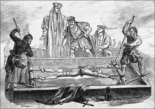 Woodcut of an heretic being tortured on the rack in the Tower of London.