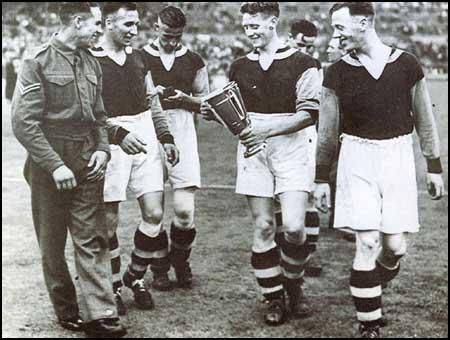 West Ham players celebrate winning the 1940 Football League Cup Final.Left to right, Corporal Norman Corbett, Ted Fenton, Charlie Bicknell,Archie Macaulay and George Foreman.