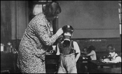 A school child tries on a gas mask in 1939.
