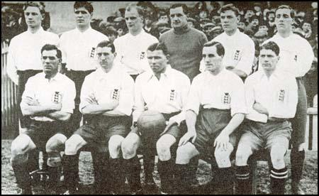The England team that played Wales in March 1921. Buchan is carrying the ball.