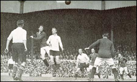 Charlie Buchan heads a ball in his first match as a Arsenal player in 1925.