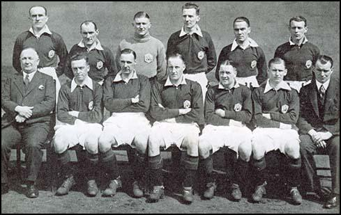 The Arsenal team in the 1932-33 season. Front (left to right): Tom Parker, Charlie Jones, Frank Moss, Herbie Roberts, Bob John and Tommy Black. Seated: Herbert Chapman, Joe Hulme, David Jack, Jack Lambert, Alex James, Cliff Bastin and Tom Whittaker.
