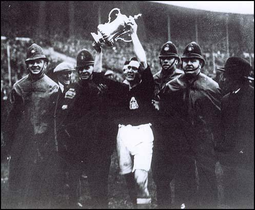 Harry Healless parades around Wembley with the FA Cup.