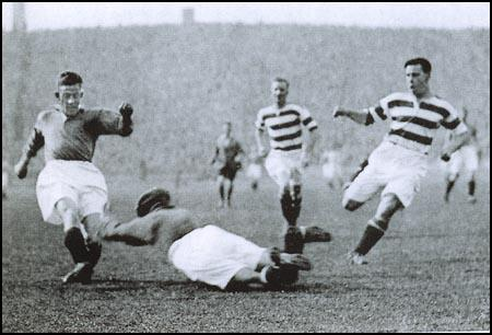 John Thomson diving at the feet of Sam English on 5th September, 1931.