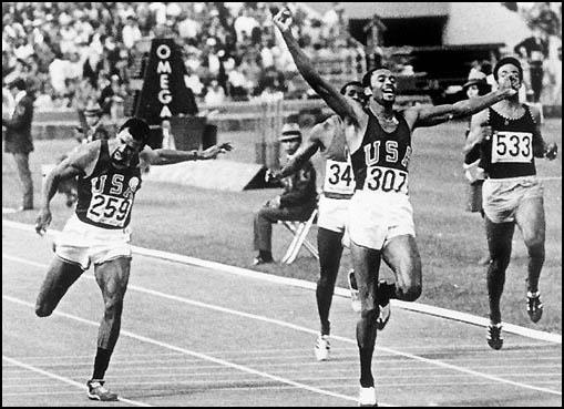 Tommie Smith beats John Carlos and Peter Norman (not in picture) in the 200m final.