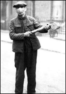 A man spraying the streetswith chemicals in 1918