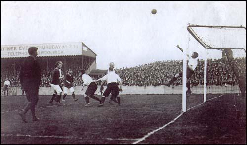 The Liverpool goalkeeper punches out a shot against Arsenal on 6th October 1906.