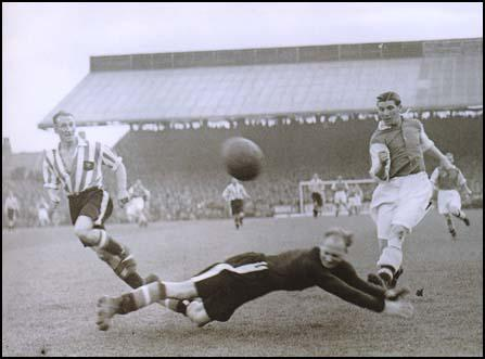 Ted Drake in action against Brentford on 8th September 1938.