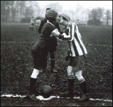 Two captains kissing before a game in 1921.
