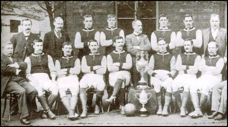 Aston Villa in April 1897. Standing from left to right, are: George Ramsay (secretary),John Grierson (trainer), Howard Spencer, James Whitehouse, Joshua Margoschis (chairman),William Evans, Jimmy Crabtree, John Lees (director). Seated, from left to right,Victor Jones (director), James Cowan, Charlie Athersmith, Johnny Campbell, John Devey,George Wheldon, John Cowan and Jack Reynolds.