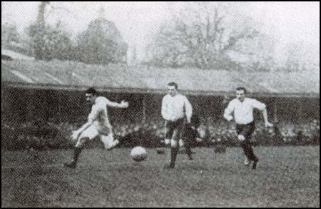 Billy Meredith races past two Bolton Wanderers defenders in the 1904 FA Cup Final.