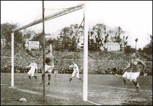 Sandy Turnbull (out of shot) scores the winning goal against Bristol City in the1909 FA Cup Final at Crystal Palace.