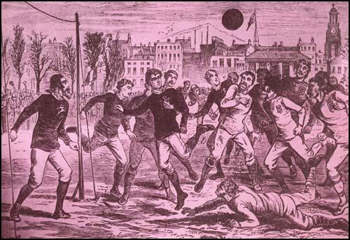 England against Scotland in 1877. The Scottish goalkeeper is on the left. At thistime the keeper wore the same colour shirt as the rest of the team.