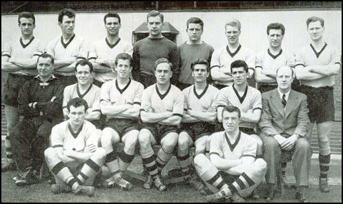 The Wolves team that won the First Division championship in 1957-58. Left to right,back row: Jerry Harris, Eddie Clamp, Eddie Stuart, Malcolm Finlayson, Noel Dwyer,Ron Flowers, Jimmy Mullen and Bill Slater. Middle row: Joe Gardiner (trainer),Norman Deeley, Peter Broadbent, Billy Wright, Bobby Mason, Colin Booth andStan Cullis (manager). Front row: Jimmy Murray and George Showell.
