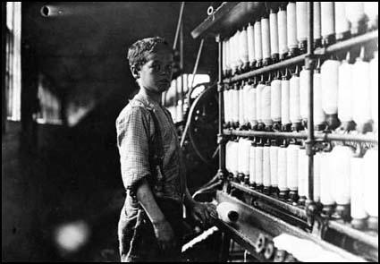 John Dempsey aged eleven working in a mule-spinningroom in Rhode Island in April 1909.
