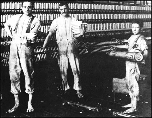 Cotton workers in an Oldham textile mill.