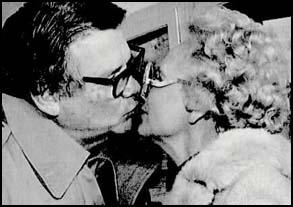 Billie Sol Estes kisses his wife, Patsy, after leaving prison in November, 1983.