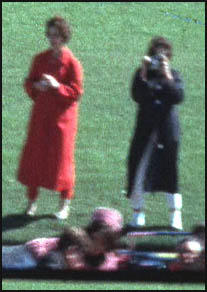 The Zapruder Film film shows the position of Jean Hill (left)and Mary Moorman when John F. Kennedy was shot.