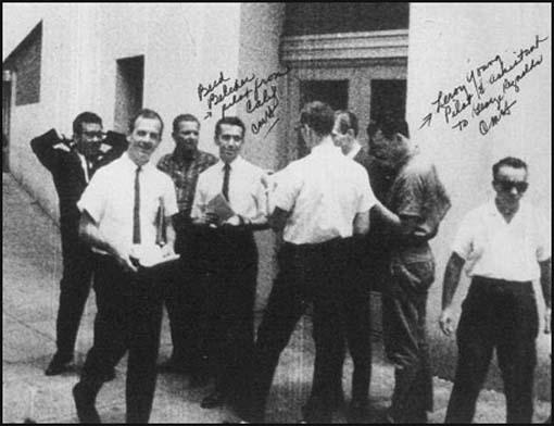 Lee Harvey Oswald handing out pamphlets in New Orleans. Holt is the man on the far right. Holt has written in the names of some of the people involved in this operation.