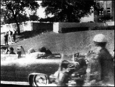 The photograph taken by Mary Moorman that shows the grassy knoll.