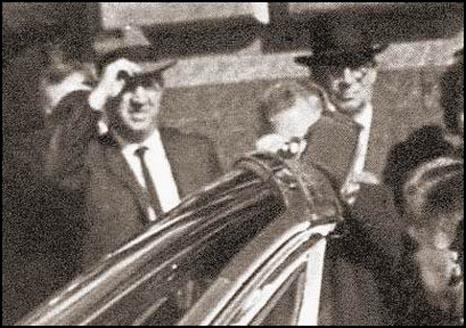 Is this Rip Robertson on the corner of Main and Houston in Dealey Plazaduring the John F. Kennedy motorcade in Dallas on 22nd November, 1963?