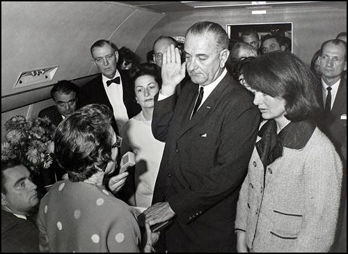 The swearing-in of Lyndon Johnson on Air Force One, photographed by Cecil Stoughton.