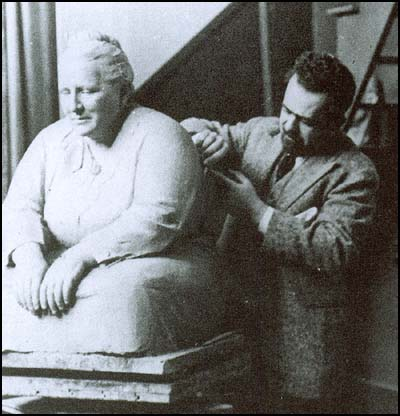 Jo Davidson woerking on a sculpture of Gertrude Stein.