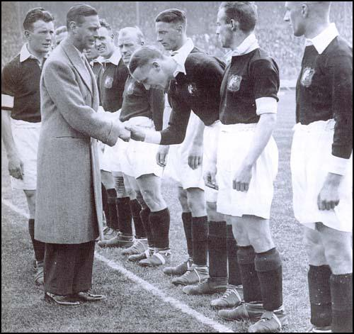 Sam Cowan introduces the future George VI to Matt Busby at the 1933 FA Cup Final.