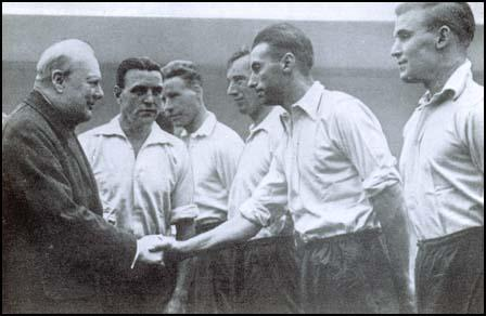 Stanley Matthews meets Winston Churchill in 1941. Also in the pictureis Eddie Hapgood and Wilf Mannion.