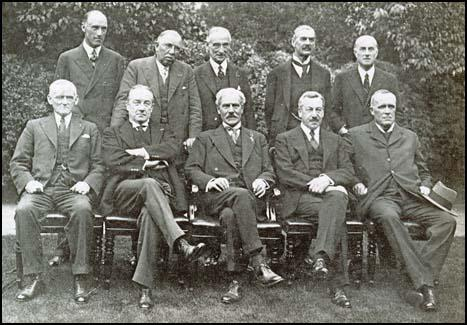 The National Government: Standing, left to right, Philip Cunliffe-Lister, Jimmy Thomas, Lord Reading, Neville Chamberlain, Samuel Hoare. Seated, left to right: Philip Snowden, Stanley Baldwin, Ramsay MacDonald, Herbert Samuel and John Sankey.