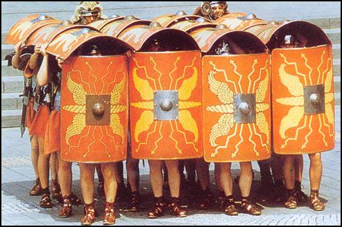 A modern reconstruction of Roman soldiers in the testudo (tortoise) formation.