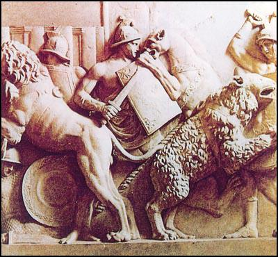 Sculptured relief of slaves fighting wild animals in the Roman Games.