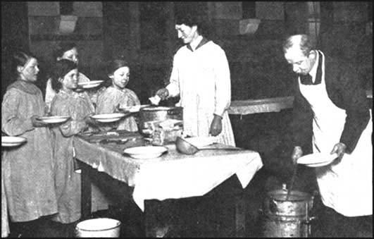 The headmaster of Green Lane School, Bradford, JonathanPriestley (father of J. B. Priestley), serving free school meals.