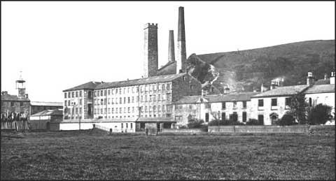 This photograph of Waterside Mill shows the original Landside cottages purchased by Joshua Fielden in 1782. The first small mill built in 1804 is next to the cottages. The building on the far right, Waterside house, was where the Fielden family. Other buildings were added over the next fifty-years. The building on the far left is the factory school built in 1827.