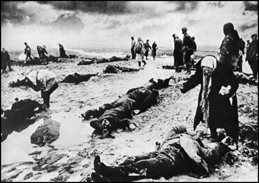 Kerch, like other parts of the Soviet Union suffered at the hands of the Schutz Staffeinel (SS).Dmitri Baltermants took this photograph of survivors seaching for friends and relatives in 1942.
