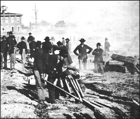 Photograph by George N. Barnard of Union Army troops pulling up railroad tracks in Atlanta (1864)