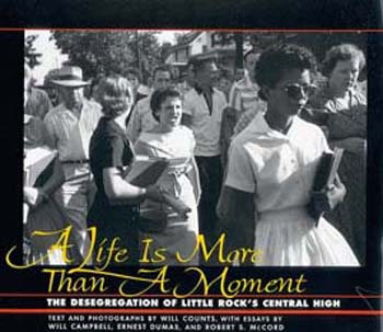 Elizabeth Eckford attempting to enter Little Rock Schoolon 4th September, 1957. The girl shouting is Hazel Massery.