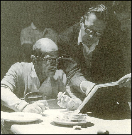 Luis Buñuel and Hugo Butler working together on a script.