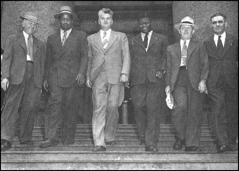 William Z. Foster, Benjamin Davis, Eugene Dennis, Henry M. Winston, JohnWilliamson and Jacob Stachel leaving the courthouse in New York (21st July, 1948)