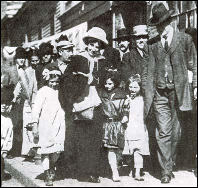 Elizabeth Gurley Flynn and Bill Haywood with children returning to Lawrence.