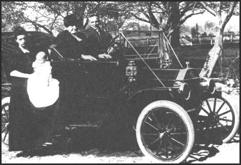 Henry Ford with his Model T car in 1912.