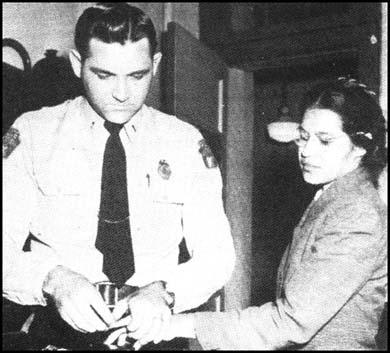 Rosa Parks having her fingerprints takenafter her arrest on 1st December, 1955.