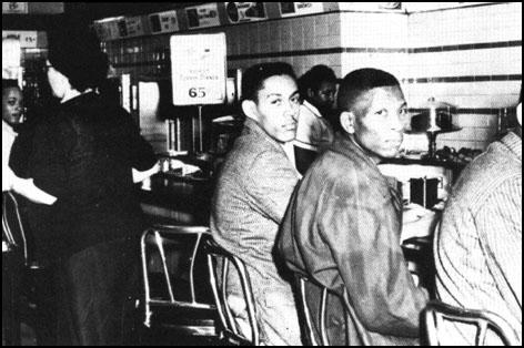 Students attempting to obtain service in Woolworths'white lunch-counter in Greensboro, North Carolina (1963)